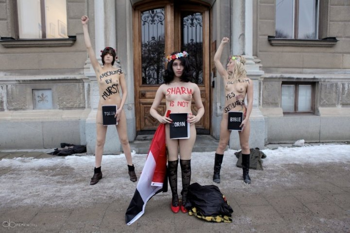 A photograph of unclothed women protesting religions