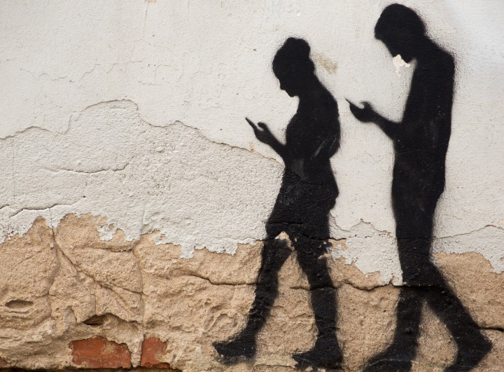 Humans Tethered to Smartphones